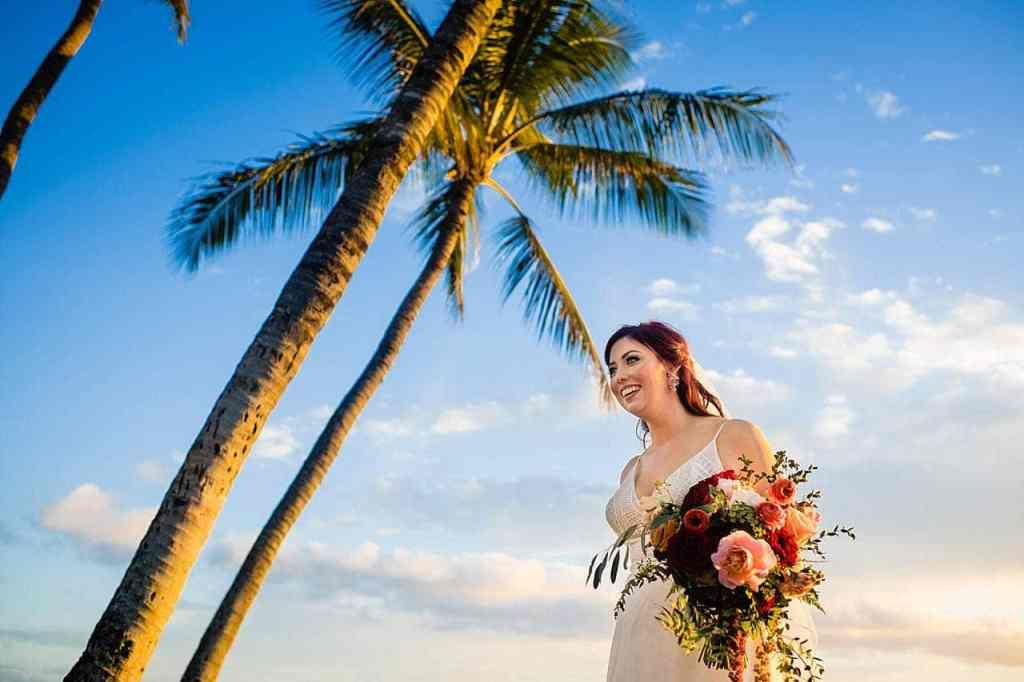bridal portrait with palm tree at white orchid beach house