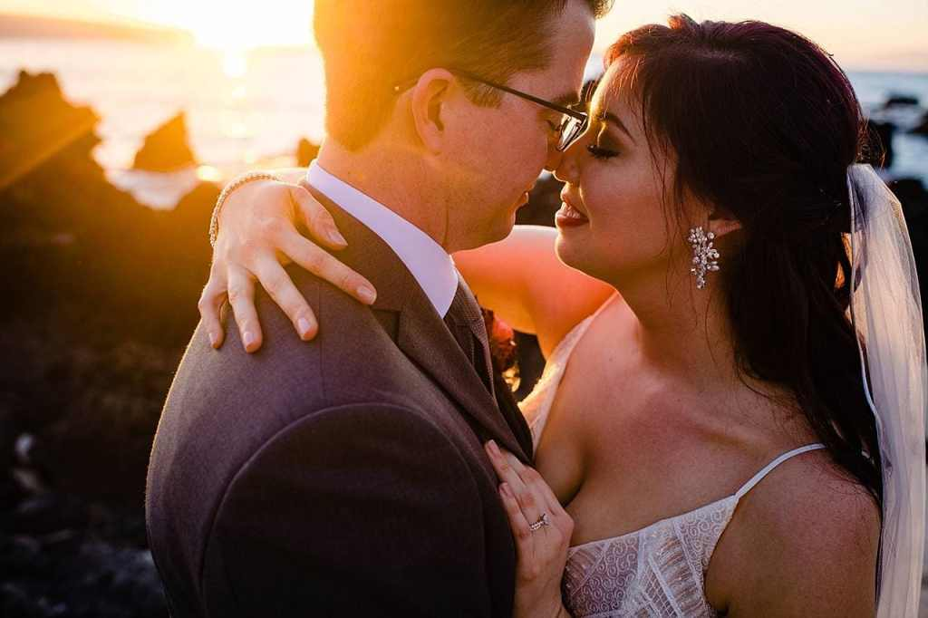intimate wedding image fo grom close to bride at white orchid beach house