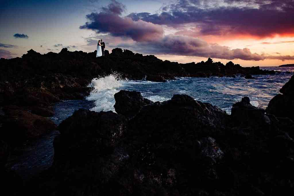bride and groom portraits on lava rocks in maui