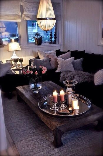 26-Awesome-Small-Living-Room-Designs-With-black-sofa-and-white-pillow-and-unique-chandelier-design