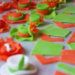 horse racing theme, custom made sugar paste decorations, horseshoes, rosettes, hats, jockey shirts