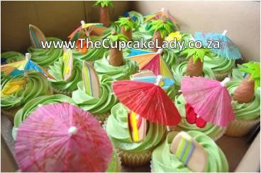 vanilla cupcakes, green vanilla butter icing, custom hand made sugar paste fondant palm trees, custom hand made sugar paste fondant surfboards, surf theme