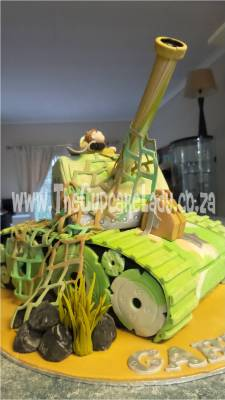 This tank-shaped cake is sculpted from vanilla cake with chocolate butter icing! Everything is handmade by me, the boots, shovel, camo net... The numbers and stars are cut outs, but no moulds were used.