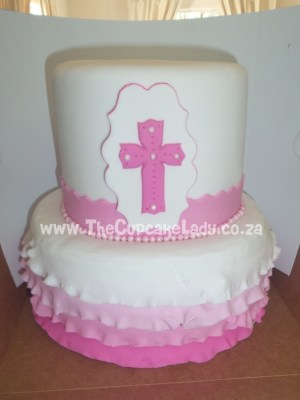 two tier cake for a christening - bottom tier carrot cake top tier vanilla cake, with pink and white ruffles