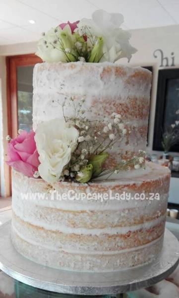 A naked wedding cake - layers of white velvet cake and white vanilla butter icing