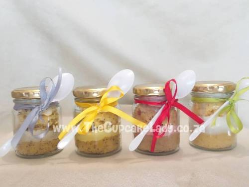 cupcake-in-a-jar, assortment of flavours, glass jar with a gold lid, disposable teaspoon and satin ribbon