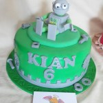 Cake artist Midrand. Cakes, cupcakes, sugar art. Custom made. Hand made. single tier chocolate cake, with a hand made sugar paste robot, nuts, bolts, washers and cogs as removable cake topper, cake artist, sugar artist, Vorna Valley, Midrand