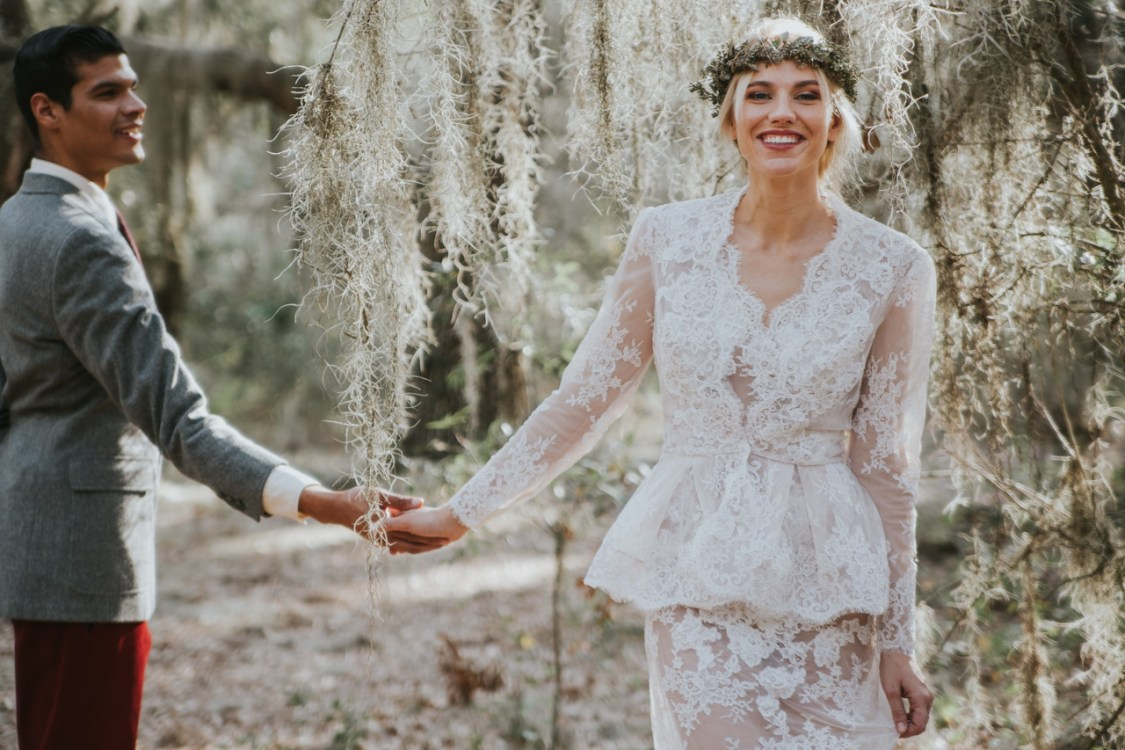 Orlando Florida Bride smiling while holding grooms hand