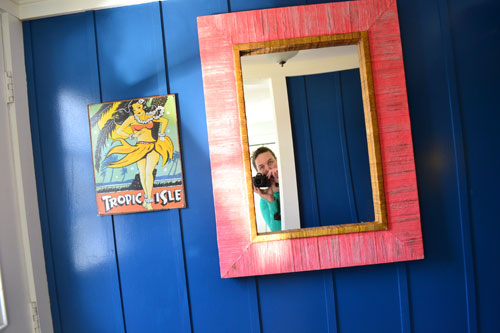 Coral Mirror With Hula Girl Art In Entry