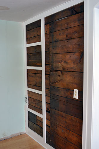 Painted Pantry Framing Against Exposed Wood Wall