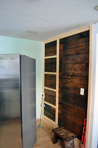 Pantry Framing Against Exposed Wood Wall