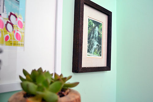 Dark Wood Picture Frame Hanging In The Bathroom