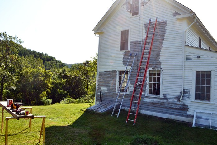 Scraping and painting the exterior of an old colonial farmhouse