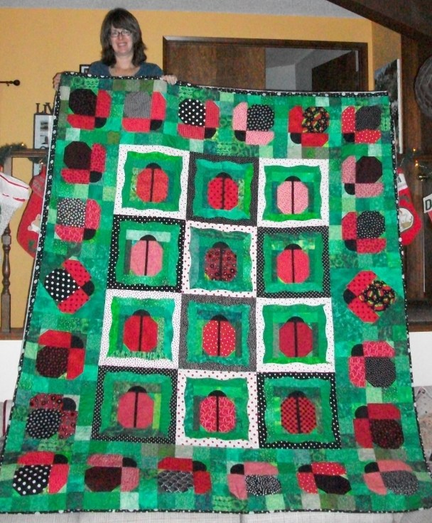 #23 My main ladybug quilt. Started back in 2008 at Road to CA. Sandy McCain quilted this one.