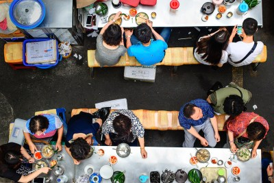 Diners at Seomun Market, South Korea by Chris Cusick