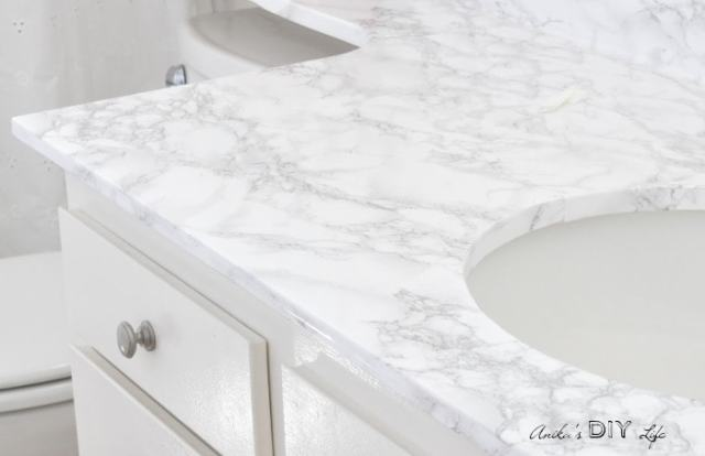 Bathroom countertops covered with marble contact paper