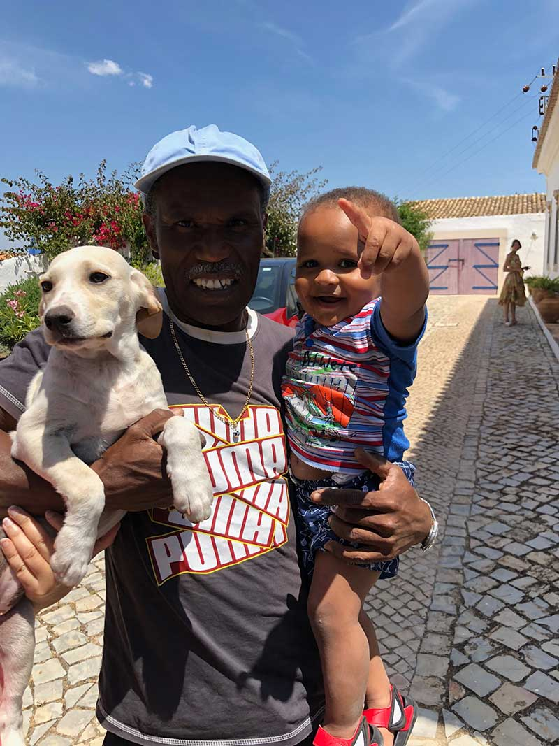 pets from Spain and Portugal: Here's Aurora Mimosa with Zim, who works at the yoga centre, and his daughter Gabrielle. Zim has been helping to care for the puppies.