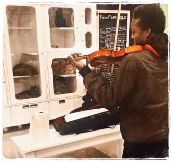 Elijah McClain plays violin to shelter cats