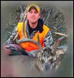 Hunter with a killed Buck deer
