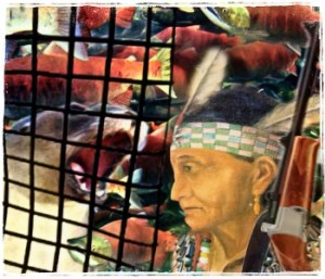 Indigenous woman with salmon and sea lion