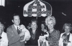 Then-Michigan governor William Milliken, Jean Marx, Cleo Hoogerhyde, and Jean Boyle at a Michigan Humane Society adoption event in 1975. (MHS photo)