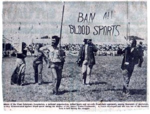 John Hicks is at right, holding the banner.