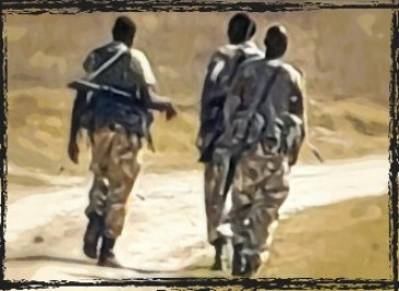 Kenya wildlife rangers walking with rifles