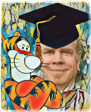 Kevin Antle in grad cap with Tigger