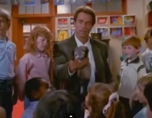 "Arnold Schwarzenegger displays ferret in ""Kindergarten Cop."""