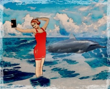 Lady bather takes photo of dolphin