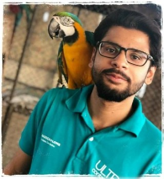 Hassan Siddiqui with parrot
