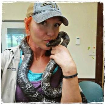 Megan Milner kissing a snake