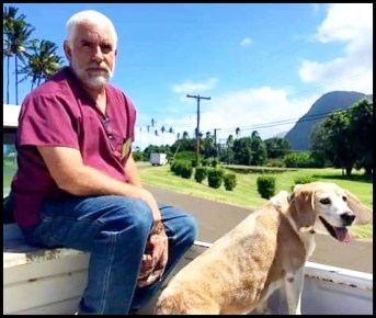 Eric Jayne, Dvm sitting with a dog in a truck