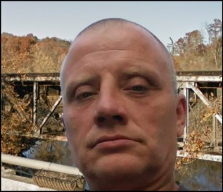 Tony Ahrens and the old trestle bridge in Newport, Tennessee