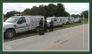 Polk County Sheriff's Office arrive to impound the Darlynn's Darlins animals. (PETA photo)
