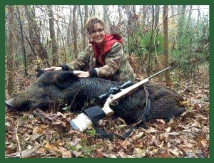 Sarah Palin with boar she shot. (Facebook photo)