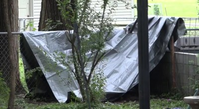 Tarp formed improvised dog house. (From WIBW-TV)