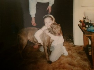 Ashton Blackwell with her childhood pit bull Rosie.