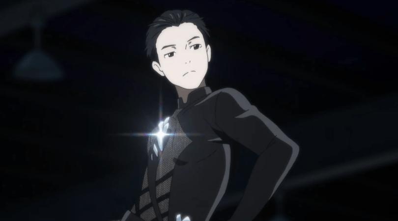 Yuri posing in his black skating costume