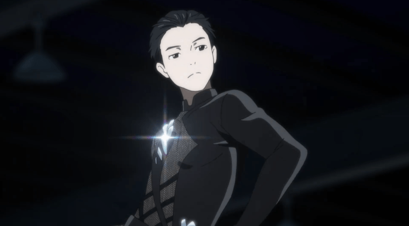 Yuri posing in his black skating costume