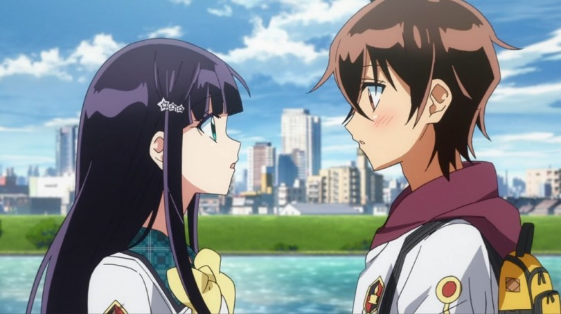 A teen boy and girl look at each other and blush