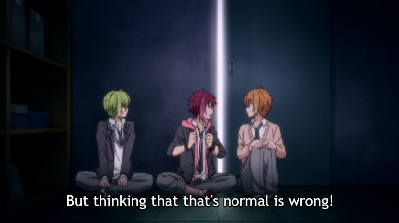 "Three boys sit cross-legged in a line by the door in a dark room, the one in the centre speaking with conviction. Subtitle: ""But thinking that that's normal is wrong!"""