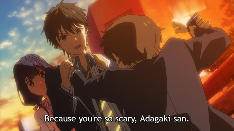 """Masamune stands in front of a surprised Aki, preventing his male classmate from attacking her with scissors. Subtitle: """"Because you're so scary, Adagaki-san."""""""