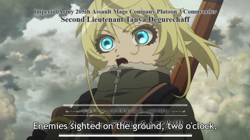 "Close-up of blonde, green-eyed Tanya speaking in front of a cloudy sky. On screen: ""Imperial Army 205th Assault Mage Company Platoon 3 Commander Second Lieutenant Tanya Degurechaff"", in English at the top of the screen and Japanese at the bottom. Subtitle: ""Enemies sighted on the ground, two o'clock."""