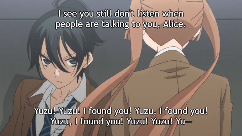 """Alice babbles at a guarded Yuzu as he leans against the wall where she knocked him down with a hug. Yuzu's subtitle: """"I see you still don't listen when people are talking to you, Alice."""" Alice's subtitle: """"Yuzu! Yuzu! I found you! Yuzu, I found you! Yuzu, I found you! Yuzu! Yuzu! Yu-"""""""