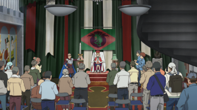 Yoshino sits with her cloak, crown and sceptre in the dingy throne room, in front of the grey-haired audience giving her a standing ovation.