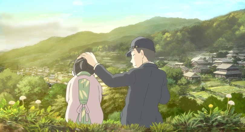 A young man in a black jacket and cap sets his hand on the head of a woman in a pink apron. A view of hills, houses and trees spreads out before them.