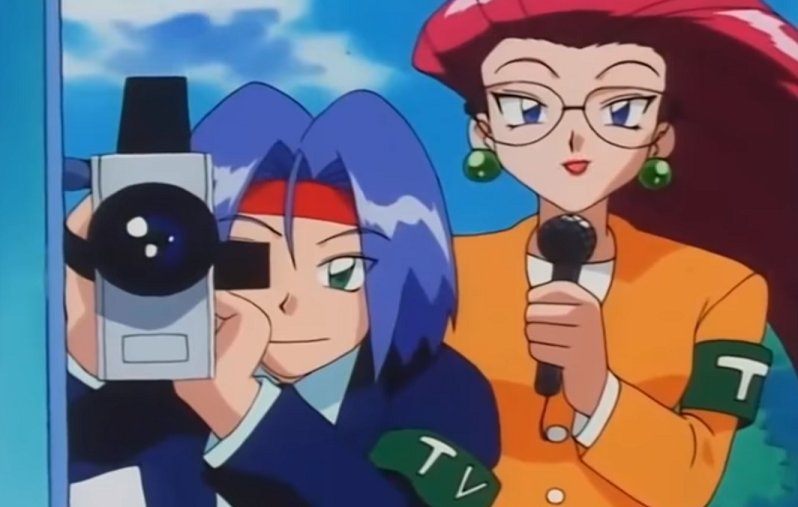 Team Rocket dressed as reporters. James is holding a camera, Jessie a microphone.