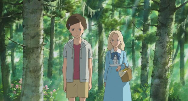 two girls stand in the woods; a blonde girl in a blue dress stands behind a short haired girl in shorts