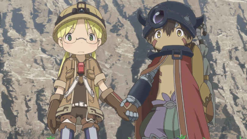 A blonde girl in a spelunking helmet and hiking gear and a shirtless boy in a metal horned helmet and red cape stand in front of a sheer cliff face, holding hands and looking stern